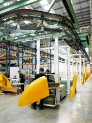 an-overhead-conveyor-system-in-jcb-heavy-products