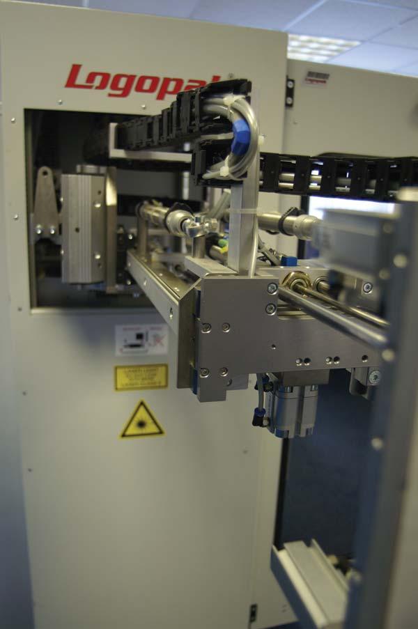 Long reach pallet labeller suits side load fork trucks for Food bar manufacturers uk